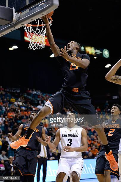 Kamari Murphy of the Oklahoma State Cowboys goes to the hoop against the Colorado Buffaloes during their game at the MGM Grand Garden Arena on...