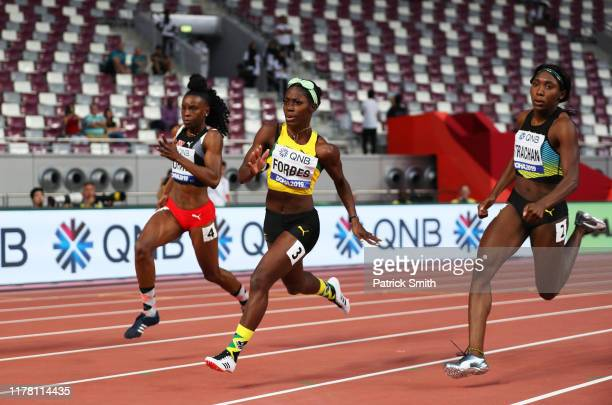 Kamaria Durant of Trinidad and Tobago Shashalee Forbes of Jamaica and Anthonique Strachan of the Bahamas compete in the Women's 200 metres heats...