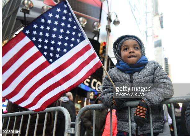 Kamarii Wickenson age 6 along with other protestors gather on Martin Luther King Jr Day during a demonstration in Times Square called Rally Against...