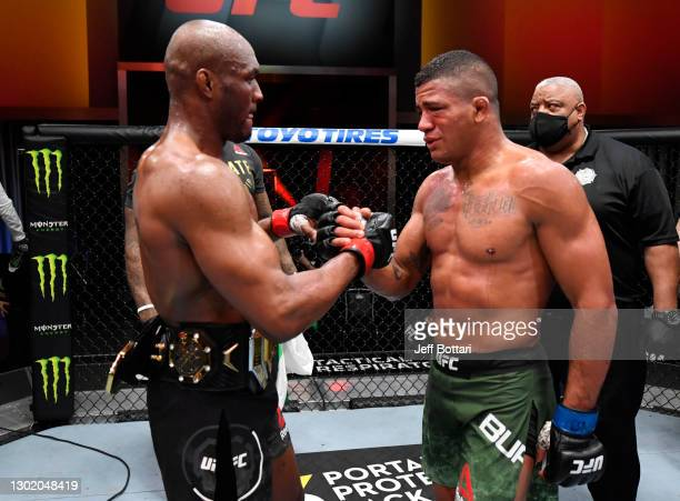 Kamaru Usman of Nigeria and Gilbert Burns of Brazil talk after their UFC welterweight championship fight during the UFC 258 event at UFC APEX on...