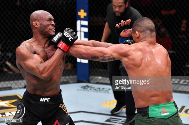 Kamaru Usman of Nigeria and Gilbert Burns of Brazil trade punches in their UFC welterweight championship fight during the UFC 258 event at UFC APEX...
