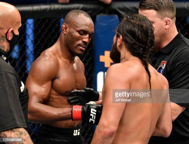 Kamaru Usman of Nigeria and Jorge Masvidal talk after the conclusion of their UFC welterweight championship fight during the UFC 251 event at Flash...