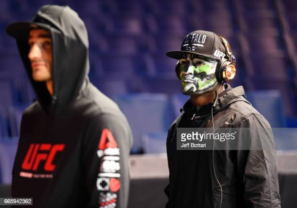 Kamaru Usman of Nigeria and Sean Strickland wait backstage during the UFC 210 weighin at KeyBank Center on April 7 2017 in Buffalo New York