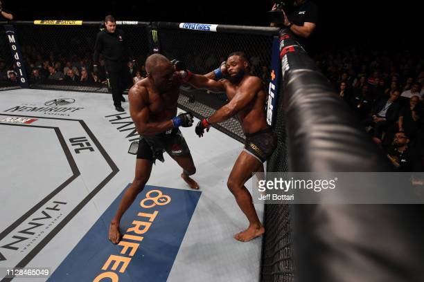 Kamaru Usman of Nigeria and Tyron Woodley trade punches in their UFC welterweight championship bout during the UFC 235 event at TMobile Arena on...
