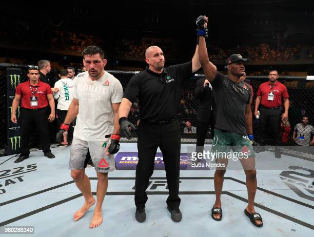 Kamaru Usman of Nigeria celebrates after his unanimousdecision victory over Demian Maia of Brazil in their welterweight bout during the UFC Fight...