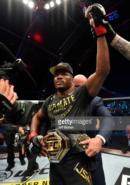 Kamaru Usman of Nigeria celebrates after his victory over Jorge Masvidal in their UFC welterweight championship fight during the UFC 251 event at...