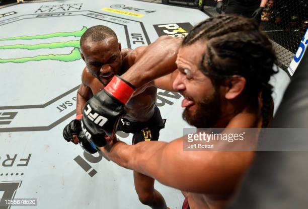 Kamaru Usman of Nigeria elbows Jorge Masvidal in their UFC welterweight championship fight during the UFC 251 event at Flash Forum on UFC Fight...