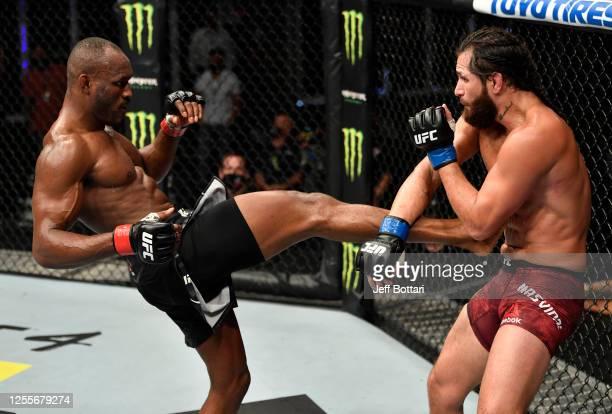 Kamaru Usman of Nigeria kicks Jorge Masvidal in their UFC welterweight championship fight during the UFC 251 event at Flash Forum on UFC Fight Island...