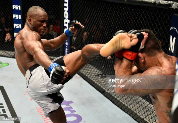 Kamaru Usman of Nigeria kicks Rafael Dos Anjos of Brazil during The Ultimate Fighter Finale event inside The Pearl concert theater at Palms Casino...