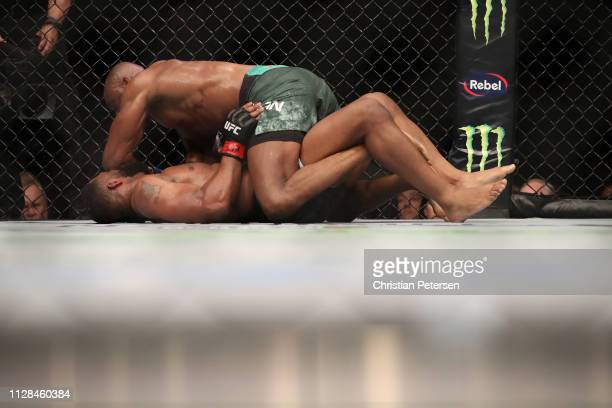 Kamaru Usman of Nigeria mounts Tyron Woodley in their UFC welterweight championship bout during the UFC 235 event at TMobile Arena on March 2 2019 in...