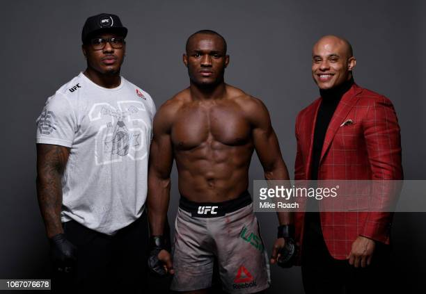 Kamaru Usman of Nigeria poses for a portrait backstage with his team after his victory over Rafael Dos Anjos of Brazil during The Ultimate Fighter...