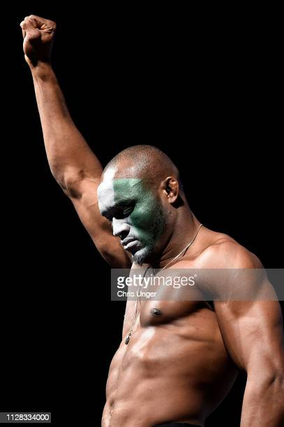 Kamaru Usman of Nigeria poses on the scale during the UFC 235 weighin at TMobile Arena on March 01 2019 in Las Vegas Nevada