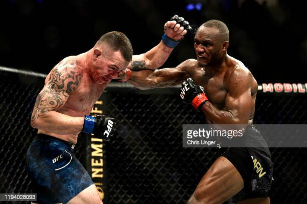 Kamaru Usman of Nigeria punches Colby Covington in their UFC welterweight championship bout during the UFC 245 event at TMobile Arena on December 14...