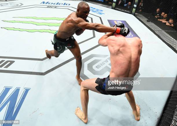 Kamaru Usman of Nigeria punches Emil Meek of Norway in their welterweight bout during the UFC Fight Night event inside the Scottrade Center on...