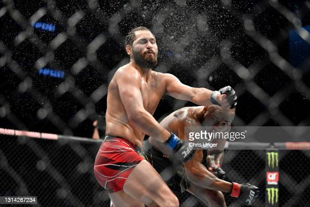 Kamaru Usman of Nigeria punches Jorge Masvidal in their UFC welterweight championship bout during the UFC 261 event at VyStar Veterans Memorial Arena...