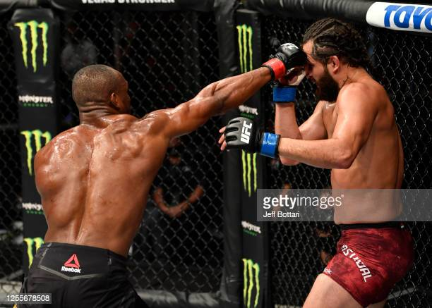 Kamaru Usman of Nigeria punches Jorge Masvidal in their UFC welterweight championship fight during the UFC 251 event at Flash Forum on UFC Fight...