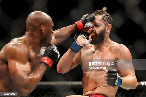 Kamaru Usman of Nigeria punches Jorge Masvidal of the United States during the Welterweight Title bout of UFC 261 at VyStar Veterans Memorial Arena...