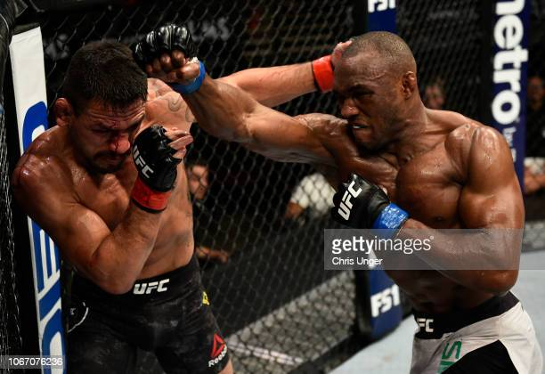 Kamaru Usman of Nigeria punches Rafael Dos Anjos of Brazil during The Ultimate Fighter Finale event inside The Pearl concert theater at Palms Casino...