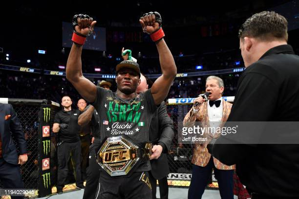 Kamaru Usman of Nigeria raises his hand in victory over Colby Covington in their UFC welterweight championship bout during the UFC 245 event at...