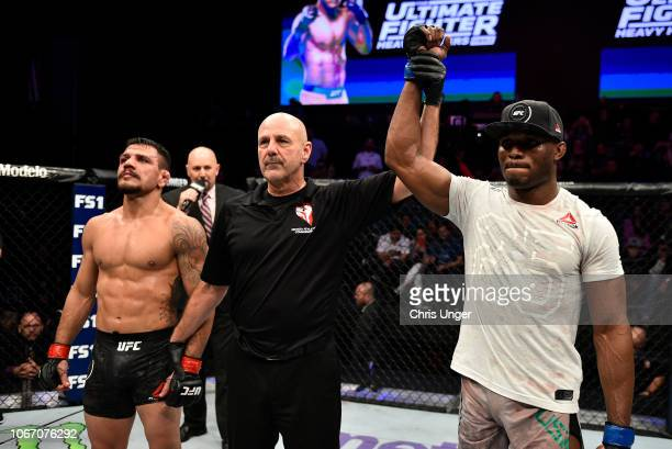 Kamaru Usman of Nigeria reacts after his victory over Rafael Dos Anjos of Brazil during The Ultimate Fighter Finale event inside The Pearl concert...