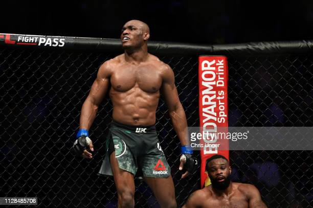 Kamaru Usman of Nigeria reacts after the conclusion of his welterweight championship bout against Tyron Woodley during the UFC 235 event at TMobile...