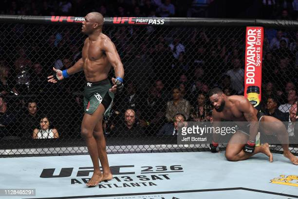 Kamaru Usman of Nigeria reacts to the end of the round against Tyron Woodley in their UFC welterweight championship bout during the UFC 235 event at...