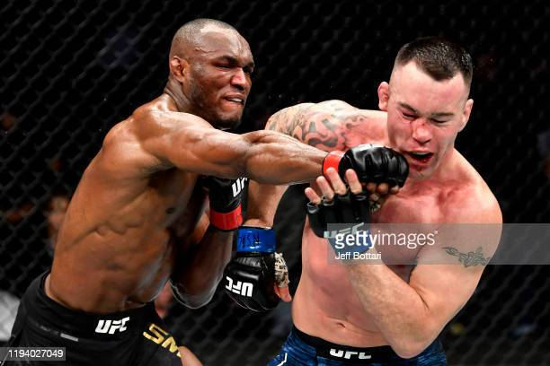 Kamaru Usman of Nigeria strikes Colby Covington in their UFC welterweight championship bout during the UFC 245 event at TMobile Arena on December 14...