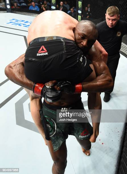 Kamaru Usman of Nigeria takes down Emil Meek of Norway in their welterweight bout during the UFC Fight Night event inside the Scottrade Center on...