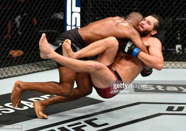 Kamaru Usman of Nigeria takes down Jorge Masvidal in their UFC welterweight championship fight during the UFC 251 event at Flash Forum on UFC Fight...