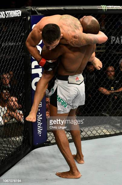 Kamaru Usman of Nigeria takes down Rafael Dos Anjos of Brazil during The Ultimate Fighter Finale event inside The Pearl concert theater at Palms...