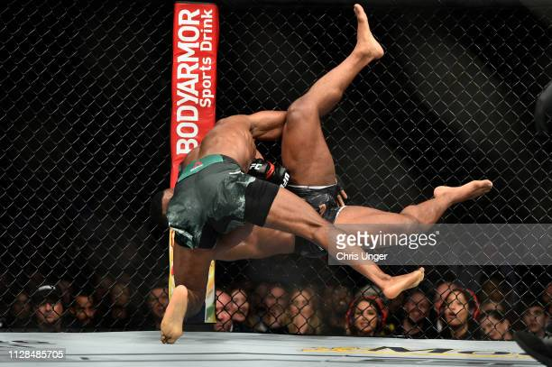 Kamaru Usman of Nigeria takes down Tyron Woodley in their welterweight championship bout during the UFC 235 event at TMobile Arena on March 2 2019 in...