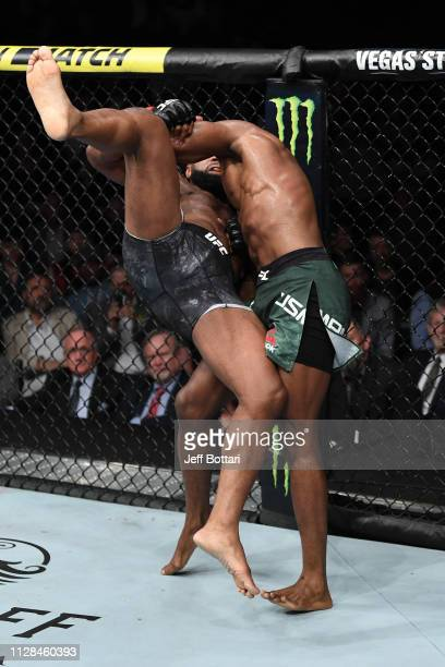 Kamaru Usman of Nigeria takes down Tyron Woodley in their UFC welterweight championship bout during the UFC 235 event at TMobile Arena on March 2...