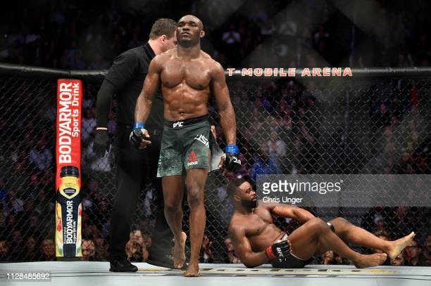 Kamaru Usman of Nigeria walks back to his corner after the a round of his welterweight championship bout against Tyron Woodley during the UFC 235...