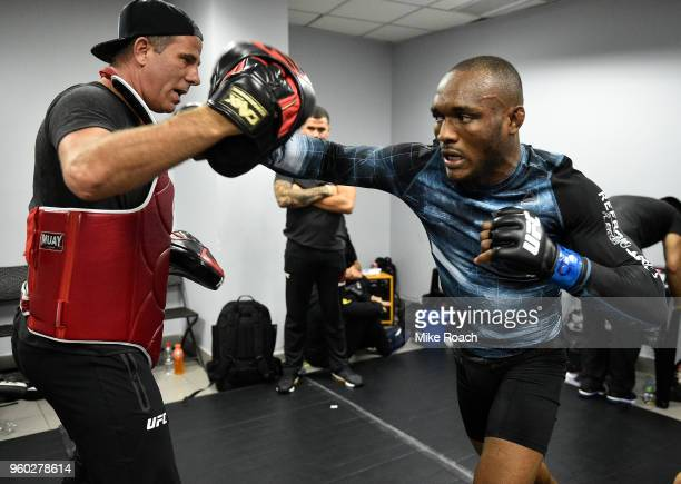 Kamaru Usman of Nigeria warms up backstage prior to his bout against Demian Maia of Brazil during the UFC Fight Night event at Movistar Arena on May...