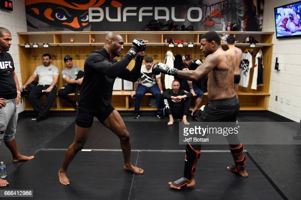 Kamaru Usman of Nigeria warms up with teammate Michael Johnson backstage during the UFC 210 event at the KeyBank Center on April 8 2017 in Buffalo...