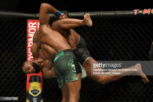 Kamaru Usman throws Tyron Woodley to the ground Usman defeated Woodley via judges decision to win the UFC welterweight championship during UFC 235 at...