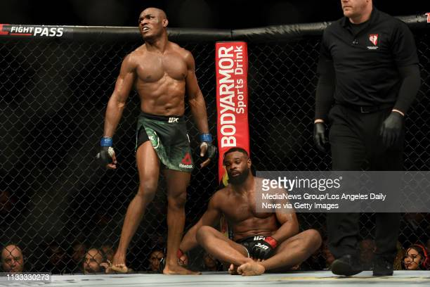 Kamaru Usman walks away from Tyron Woodley after a five round fight Usman defeated Woodley via judges decision to win the UFC welterweight...