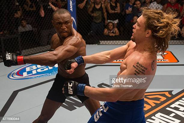 Kamarudeen Usman punches Steve Carl during the filming of The Ultimate Fighter: American Top Team vs Blackzilians on February 24, 2015 in Coconut...