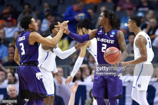 Kamau Stokes and Cartier Diarra of the Kansas State Wildcats react after a play against the Creighton Bluejays in the first round of the 2018 NCAA...