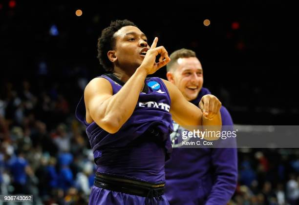 Kamau Stokes of the Kansas State Wildcats celebrates after defeating the Kentucky Wildcats during the 2018 NCAA Men's Basketball Tournament South...