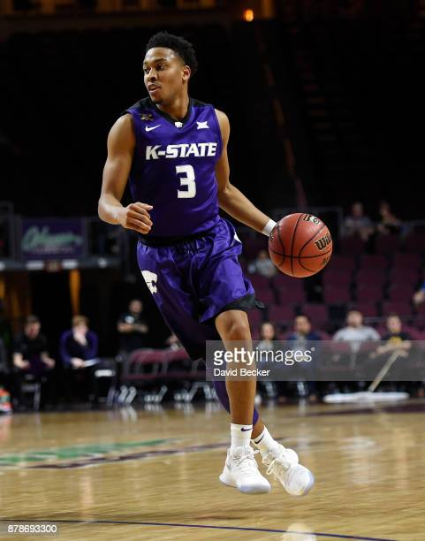 Kamau Stokes of the Kansas State Wildcats drives the ball against the George Washington Colonials during the 2017 Continental Tire Las Vegas...