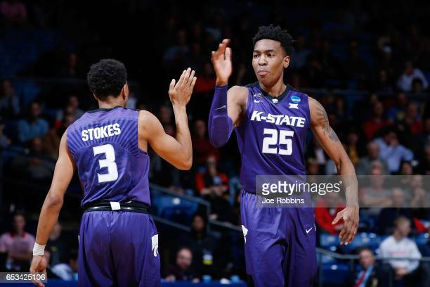 Kamau Stokes of the Kansas State Wildcats high fives Wesley Iwundu in the second half against the Wake Forest Demon Deacons during the First Four...