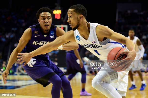 Kamau Stokes of the Kansas State Wildcats looks to defend Davion Mintz of the Creighton Bluejays during the first round of the 2018 NCAA Men's...
