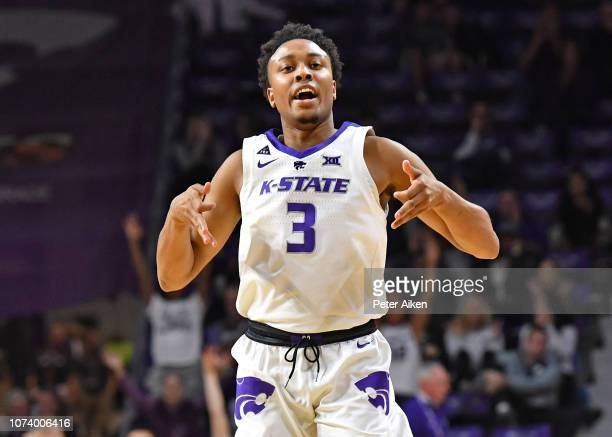 Kamau Stokes of the Kansas State Wildcats reacts after hitting a three point shot against the Georgia State Panthers during the second half on...