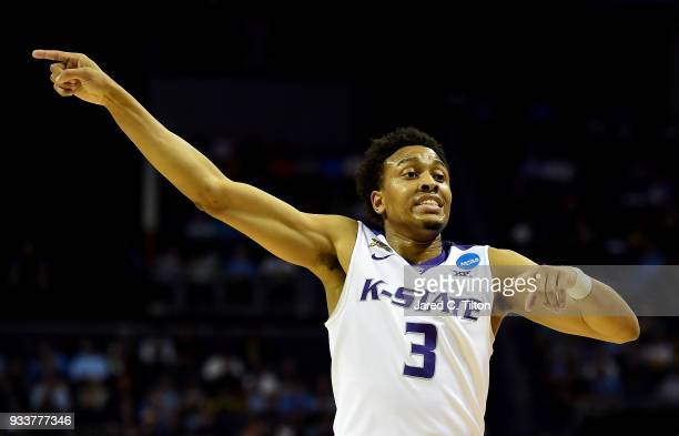 Kamau Stokes of the Kansas State Wildcats reacts against the UMBC Retrievers during the second round of the 2018 NCAA Men's Basketball Tournament at...