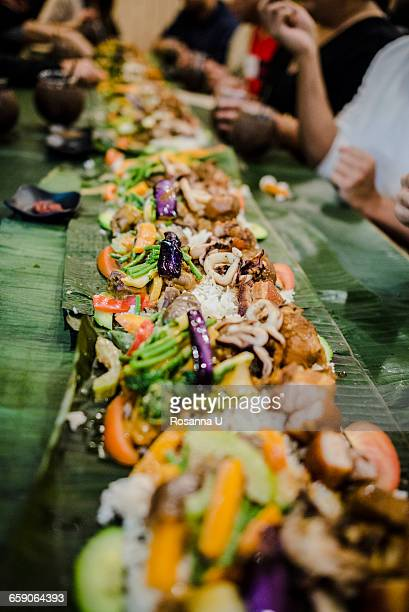 kamayan. filipino styled meal where you eat with your hands, toronto, ontario, canada - filipino culture stock pictures, royalty-free photos & images