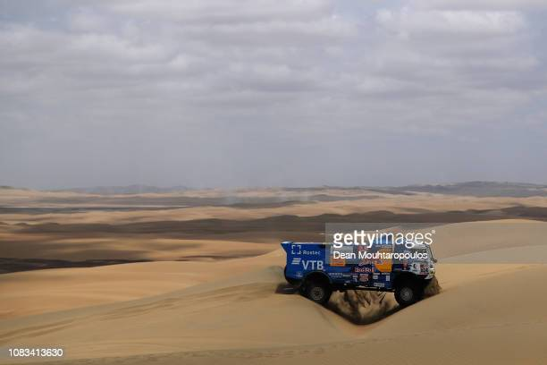 Kamaz - Master no. 514 KAMAZ 43509 T4 2 truck driven by Dmitry Sotnikov of Russia and Dmitrii Nikitin of Russia and Ilnur Mustafin of Russia compete...