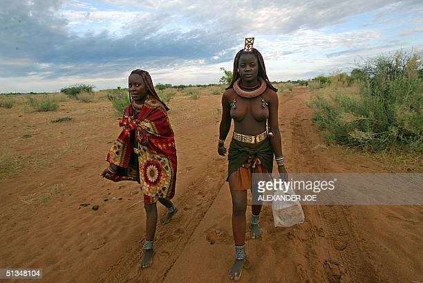 Kambindja Uahuna and her younger sister from the Himba tribe walk to school 27 November 2002 2km from their village in Otjandjamuenjo AIDS has been...