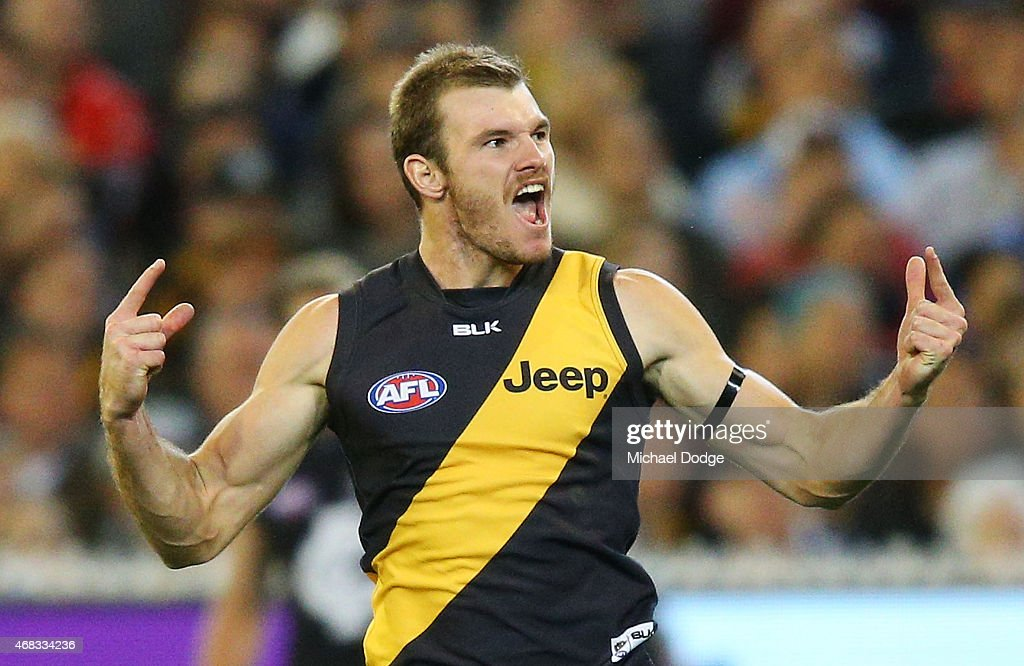 Kamdyn McIntosh of the Tigers celebrates a goal during the round one AFL match between the Carlton Blues and the Richmond Tigers at Melbourne Cricket Ground on April 2, 2015 in Melbourne, Australia.