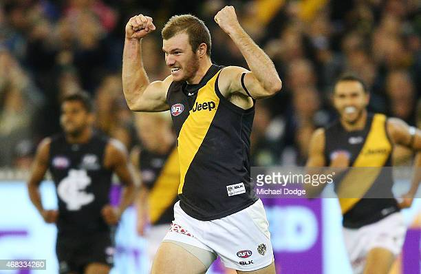 Kamdyn McIntosh of the Tigers celebrates a goal during the round one AFL match between the Carlton Blues and the Richmond Tigers at Melbourne Cricket...